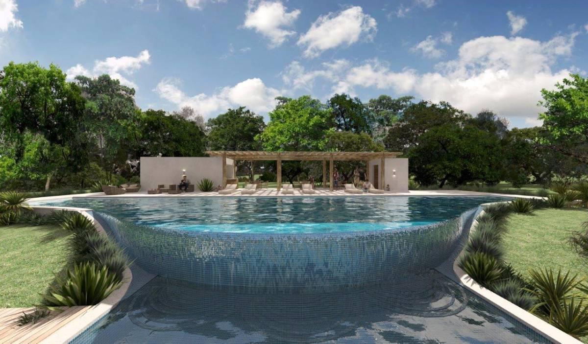 Piscina com raia de 25 metros e queda de agua para a piscina das crianças