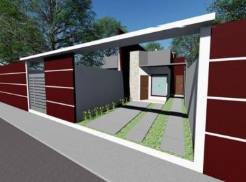 Casa linear com terraço gourmet e quintal a 200 metros da Lagoa de Iriry e a Praia de Costazul