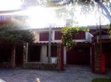 Casa · 560m² · 5 Quartos · 3 Vagas
